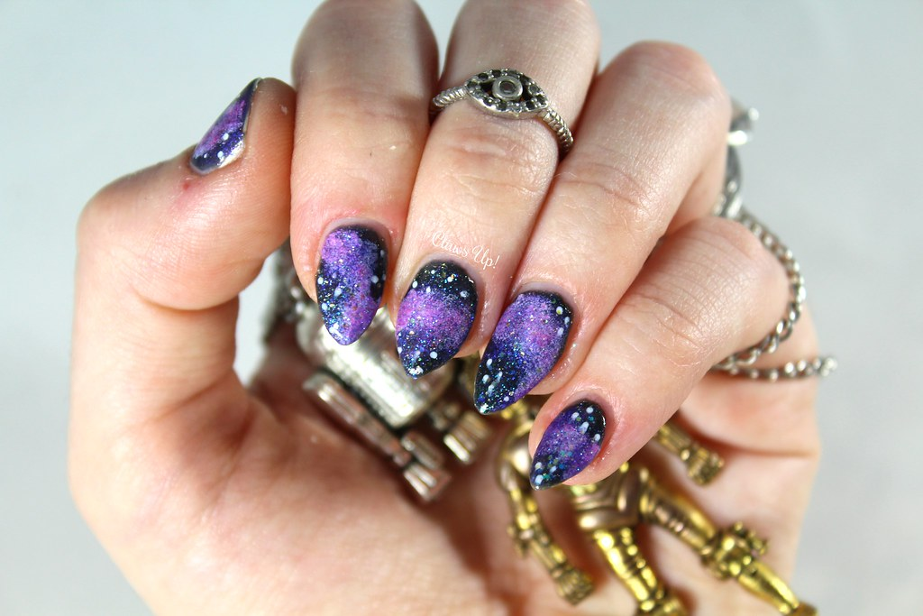 Purple galaxy nail art
