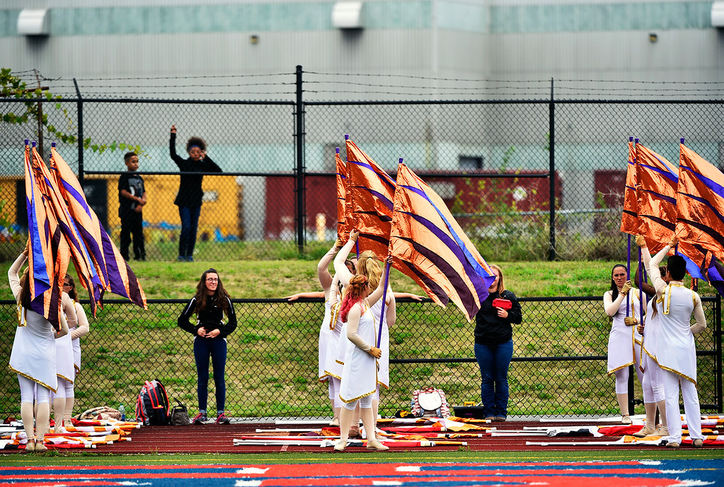 © 2016 by The York Daily Record/Sunday News. Two children watch from the other side of the fence as members of the Red Lion March Band prepare for their halftime show during a YAIAA football game Saturday, Sept. 24, 2016, at Small Field in York.