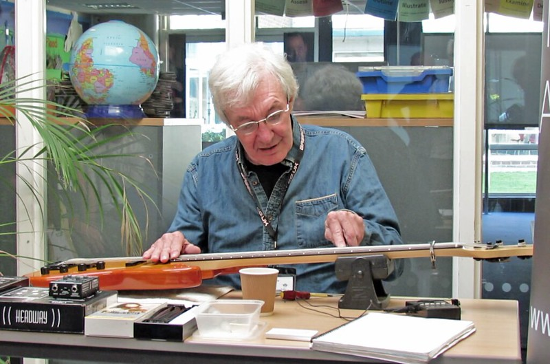 Robert shows how to use the feeler gauge to measure the action