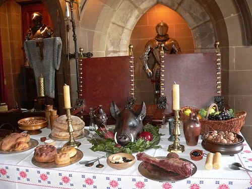 medieval feast set in the great hall at warwick castle