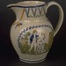 Moulded jug with relief designs