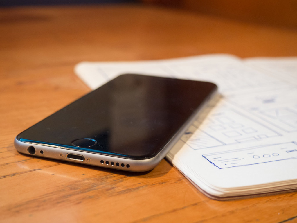 ... Phone and Journal on Desk - by Image Catalog