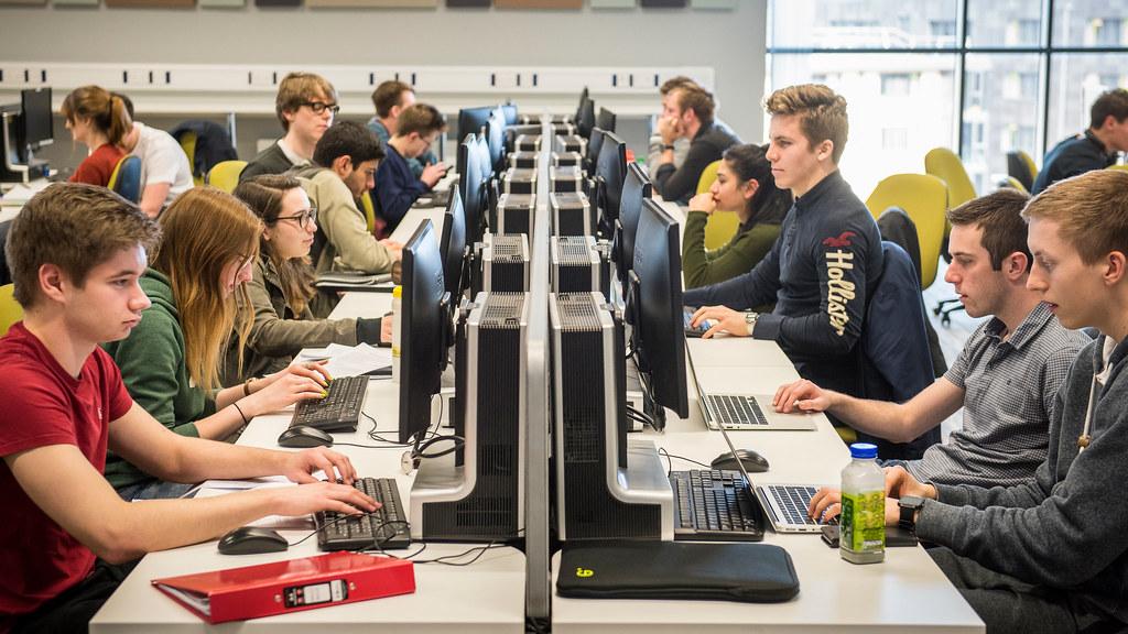 Students sat at computers