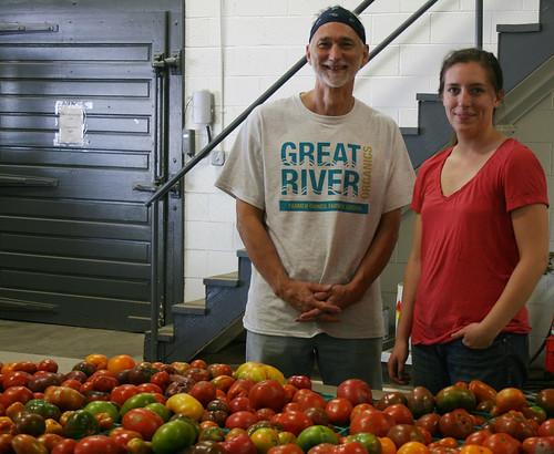 Tomatoes inspected by Great River Organics board member Michael Jones and General Manager Charlotte Graham
