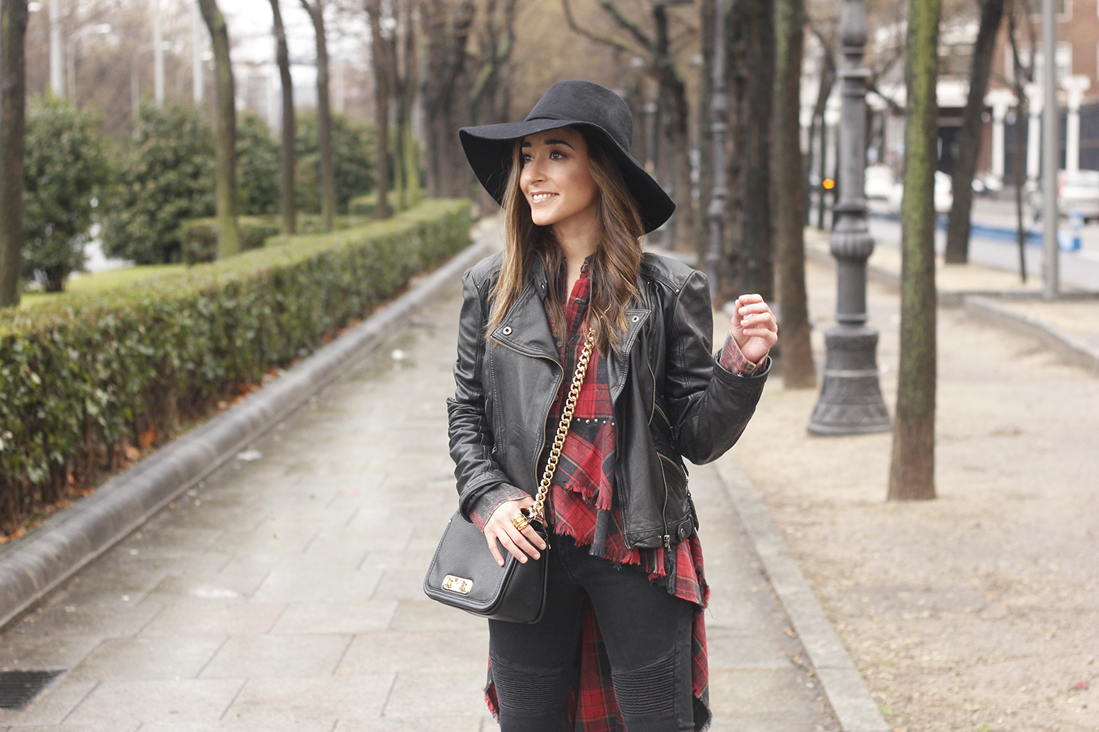 Shirt with tartan print and frills black jeans coach bag heels accessories style fashion outfit10