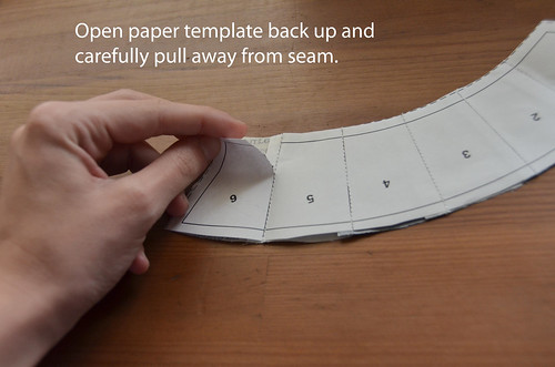 2. Fold back, and carefully pull at seam perforation. Hold down seam if necessary.