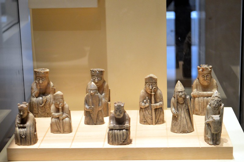 this is a picture of the lewis chessmen on display in a museum