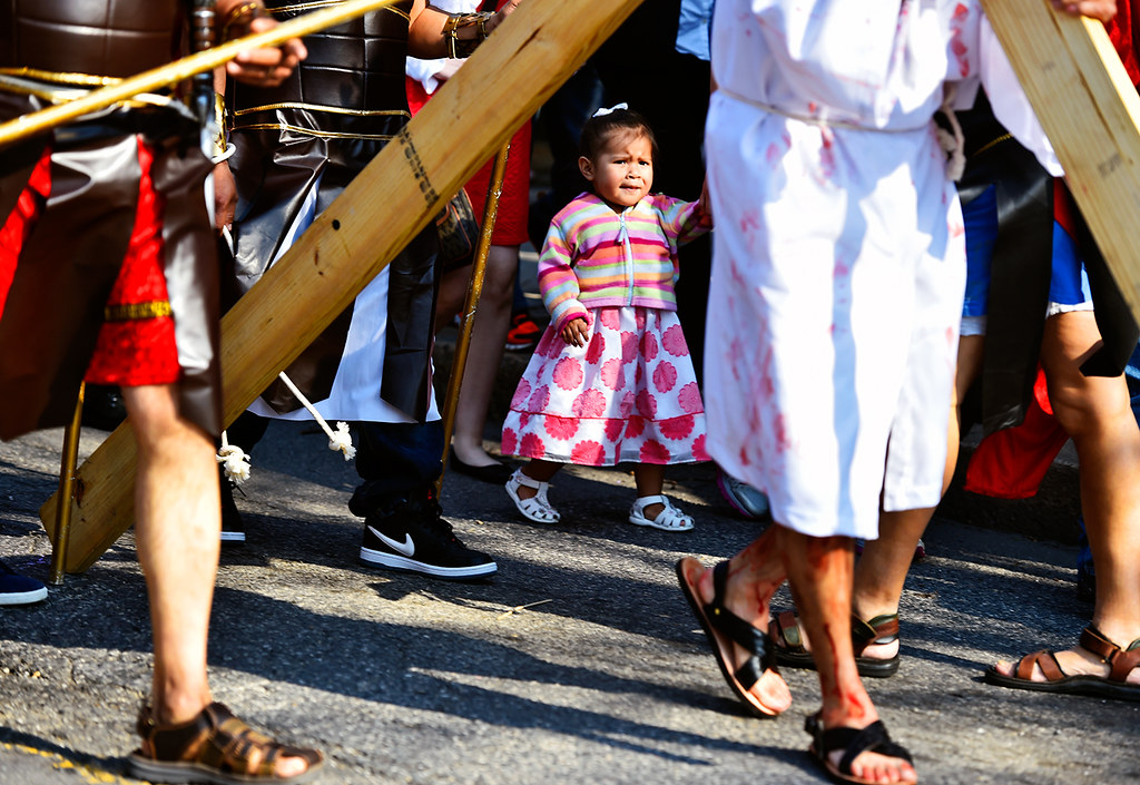 © 2016 by The York Daily Record/Sunday News. Fabiola García, 2, walks down East College Avenue behind men performing as Jesus Christ and Roman guards during a Good Friday street procession held by the Immaculate Conception of the Blessed Virgin Mary Church Friday, March 25, 2016, in York.