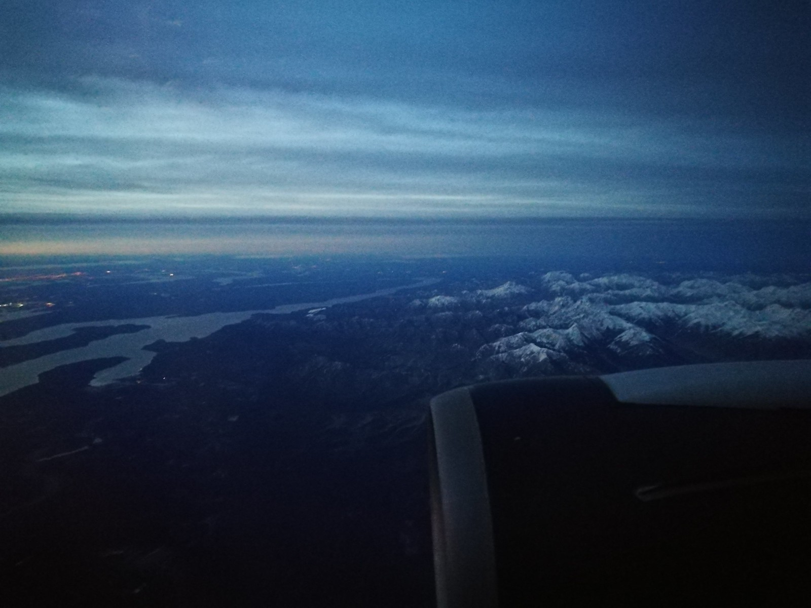 Flying past bay and mountains