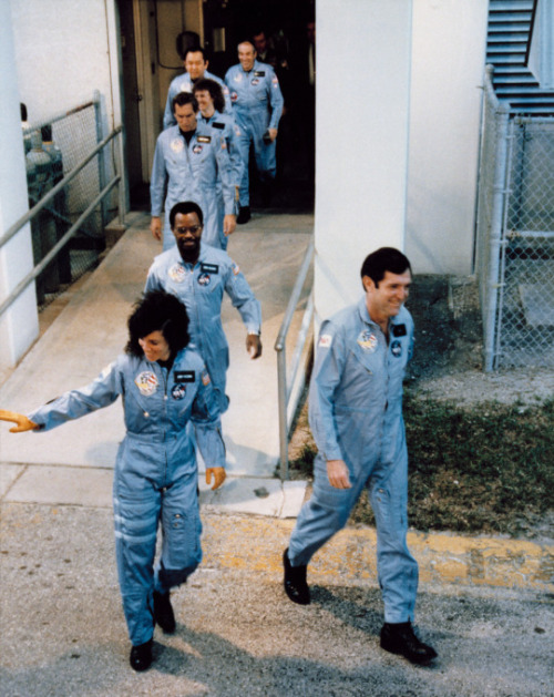 The crew of mission STS-51L on the way to board the Space Shuttle Challenger on January 28, 1986