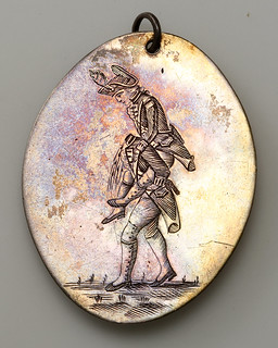 Headless soldier medal obverse