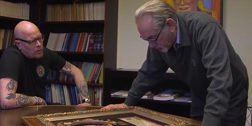 Don KAgin examining framed Emperor Norton note