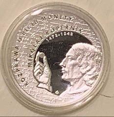 2017 Copernicus examining a coin obverse