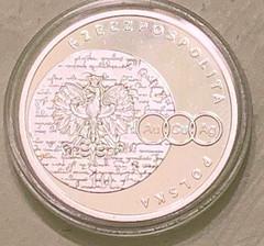2017 Copernicus examining a coin reverse
