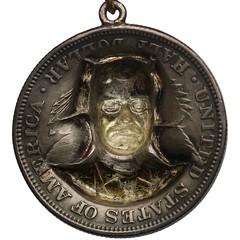 Theodore Roosevelt Repoussé Badge reverse
