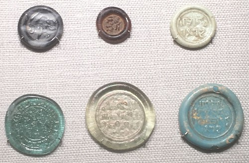 Glass coin weights