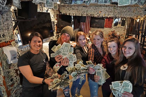 Hampton Beach Goat bar employees with dollars from walls