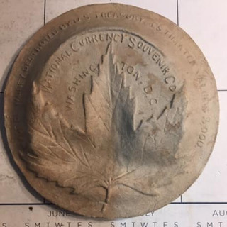 Macerated currency U.S. Capitol plate back