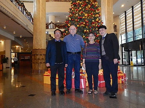 Phat Ngoc Mai with Howard and Phung Daniel and his banker-interpreter