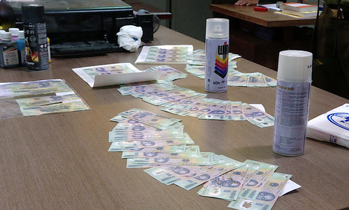 counterfeit money ring busted in Vietnam