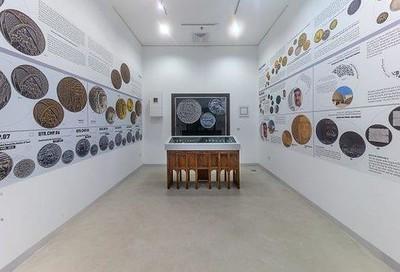 Qatar artist creates coin designs