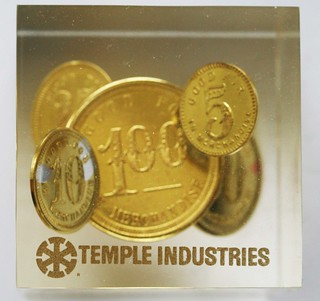 Temple Industries Southern Pine Lumber Company tokens in Lucite front