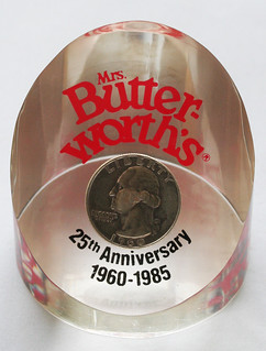 Mrs Butter-Worth coin in Lucite