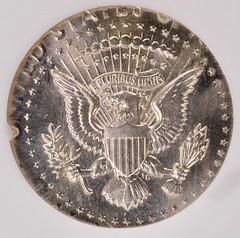 1964 Kennedy Half Struck on a Clad Quarter Planchet reverse
