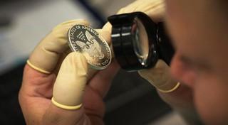 Examining 2013 silver eagle at US Mint