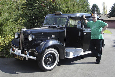 Bill McKivor with antique car
