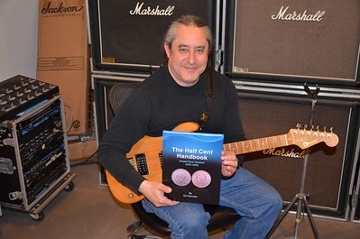 Ed Fuhrman with guitar and book