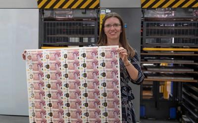 Bank of England Sarah John with £50 note sheet