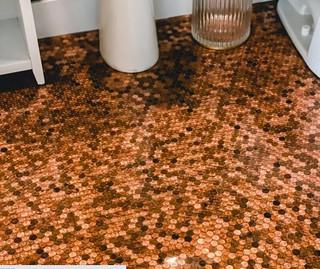 Floor tiled in pennies