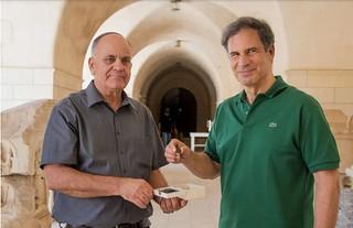 Israel Antiquities Authority director Eli Eskosido with astronaut Eytan Stibbe