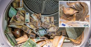 German Bank Launders Notes Damaged in Flood