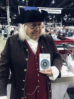Pat McBride as Ben Franklin holding Jeff Garrett's Libertas Americana medal at the 2021 ANA WFM