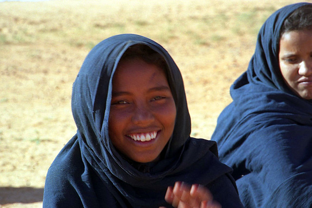 Young girl smiles in Adrar, Mauritania