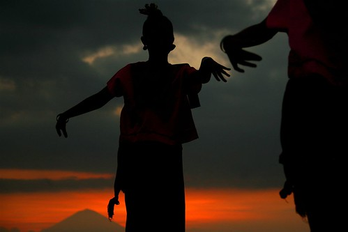 Traditional dancers in front of Mount Aggun, Lombok, Indonesia | by Eric Lafforgue