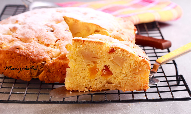 Apple and apricot cake on wire rack