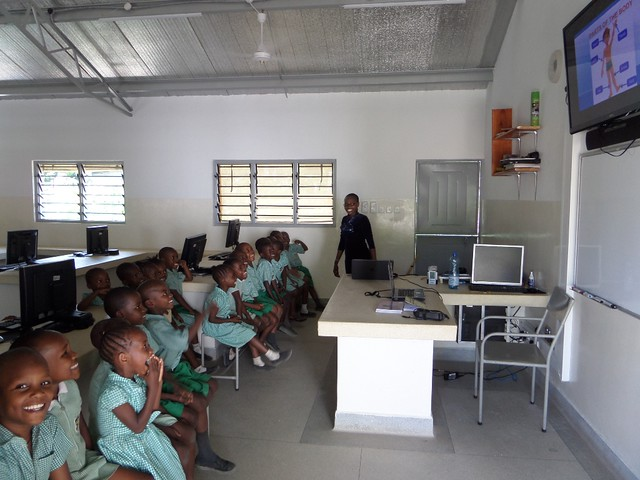 Madam Jane with her class in the IT Lab