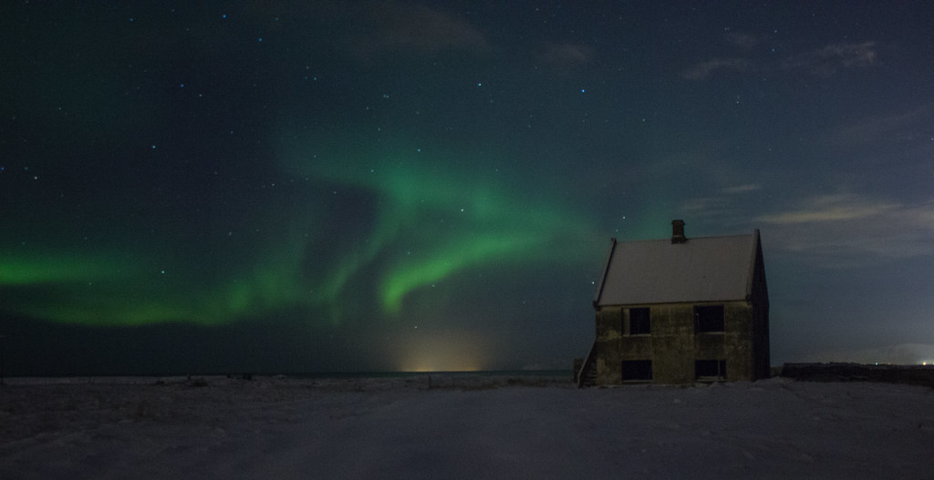 The northern lights over an abandoned house in Iceland