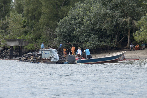 Clean up on Northern Ubin after oil spill in East Johor Strait