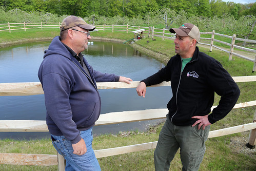 "Al Rose discusses his fourth-generation Red Apple ""green"" Farm with NRCS' Soil Conservationist Dave Bacon."