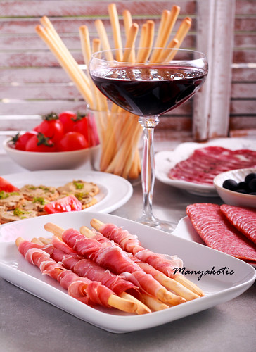 Mix of meat products and  appetizers served