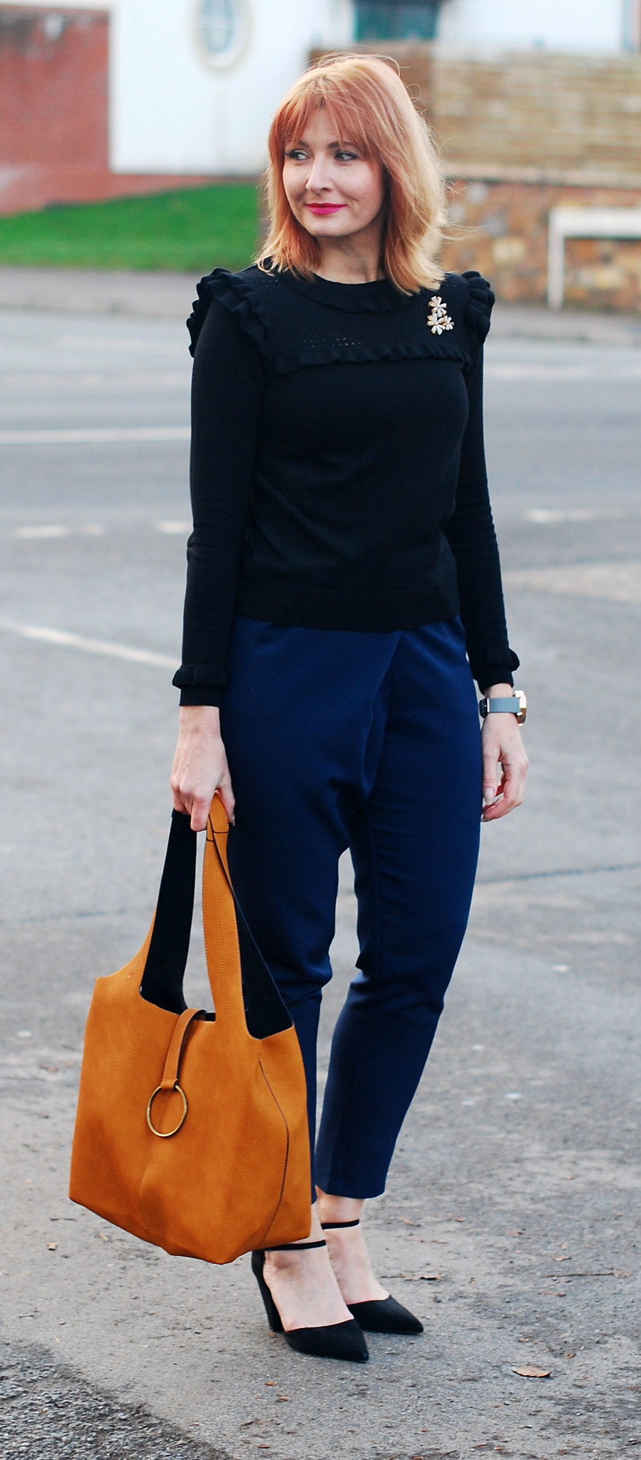 Navy and black together: Navy peg leg trousers \ black ruffled sweater \ black pointed heels \ mustard bucket bag | Not Dressed As Lamb, over 40 style