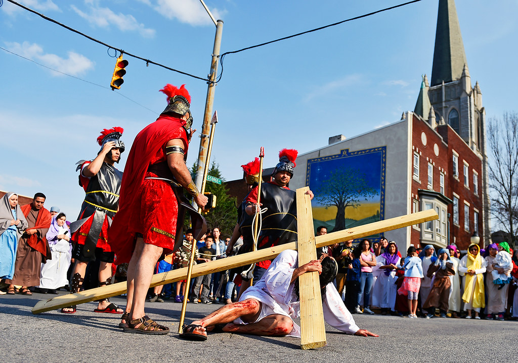 © 2016 by The York Daily Record/Sunday News. Jesús Solorio, performing as Jesus Christ, falls for the third time at South George Street and College Avenue during a Good Friday street procession held by the Immaculate Conception of the Blessed Virgin Mary Church Friday, March 25, 2016, in York.