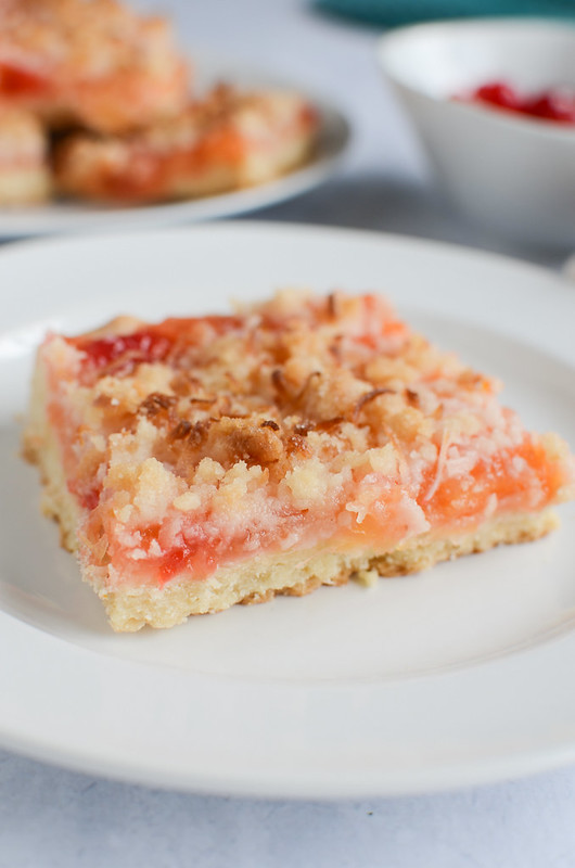 Ambrosia Streusel Bars - a shortbread crust with a pineapple, orange, and cherry filling and topped with delicious coconut streusel!