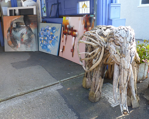 paintings and a 1m tall driftwood elephant sculpture, at a gallery in Bowness