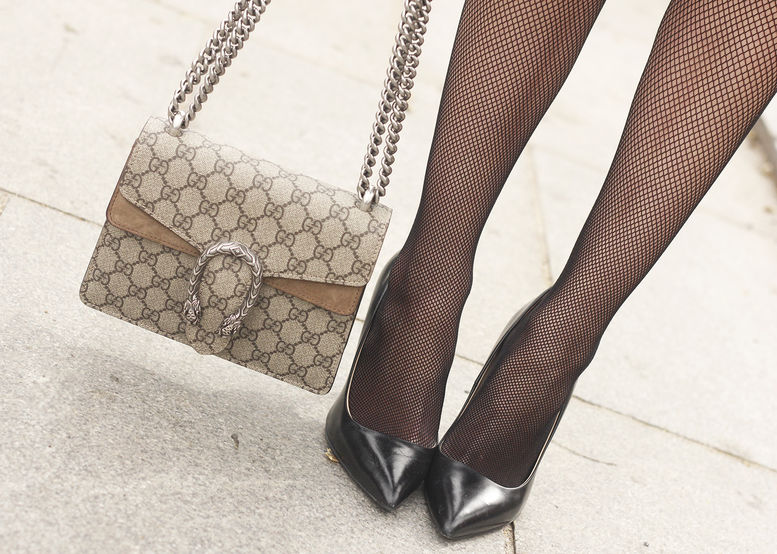 Ruffled striped shirt Fishnet tights black skirt heels gucci bag style fashion outfit 09