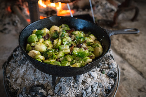 Brussels Sprouts Cooking Over Coals on Dutch Oven | by goingslowly